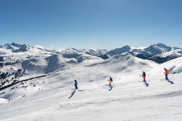 Group of Skiers on a Sunny Spring Day - Photo by Vince Emond